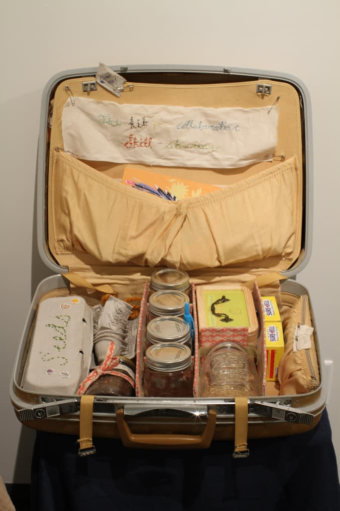 Vintage suitcase containiing canning supplies