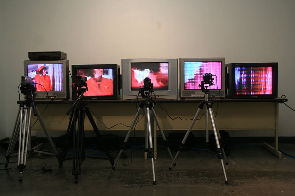 Installation with five vintage TVs live-monitoring their own image